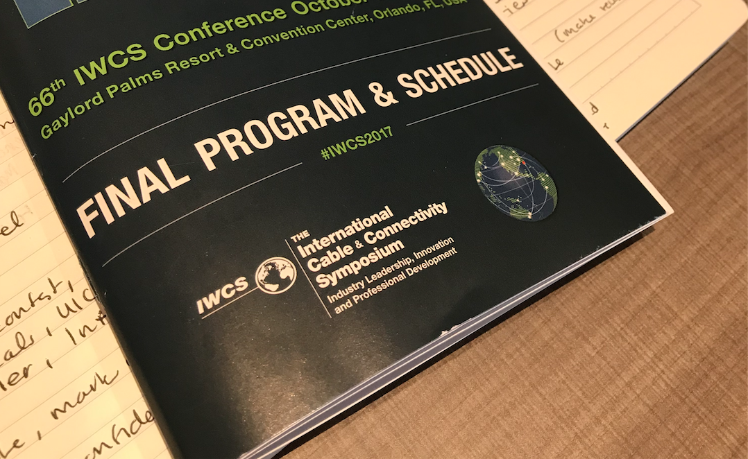 Here, the IWCS conference hashtag is printed on the program and schedule.